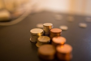 piles-of-coins-on-table
